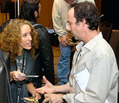Music Supervisor Jonathan Weiss taking music from a TAXI member after his panel at the Road Rally.