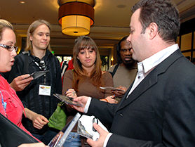 Film & TV Music Publisher Ted Lowe, networking with TAXI members outside the Road Rally ballroom.