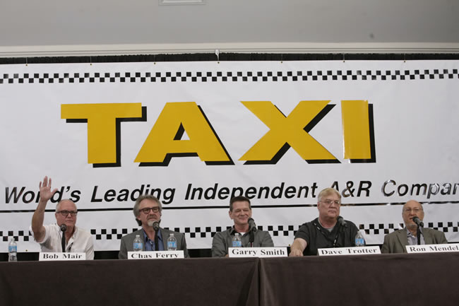 Music Library Executives Bob Mair, Chas Ferry, Garry Smith, Dave Trotter, and Ron Mendelsohn listen to TAXI member's music during their panel at Road Rally 2013. Bob Mair raises his hand and says, 'I'd like to get a copy of that song!'