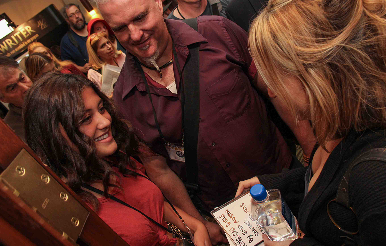 Hollywood Film Music Supervisor Beth Amy Rosenblatt takes CDs from a member after the amazing Music Supervisor Listening and Q&A Panel held on Saturday at the TAXI Road Rally.