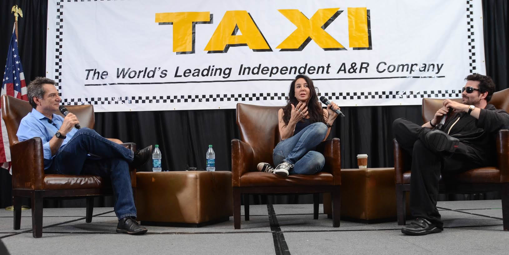 Antonina Armato (center) makes a point   during the Rock Mafia interview, while her partner Tim James (right)   looks on and smiles in agreement.