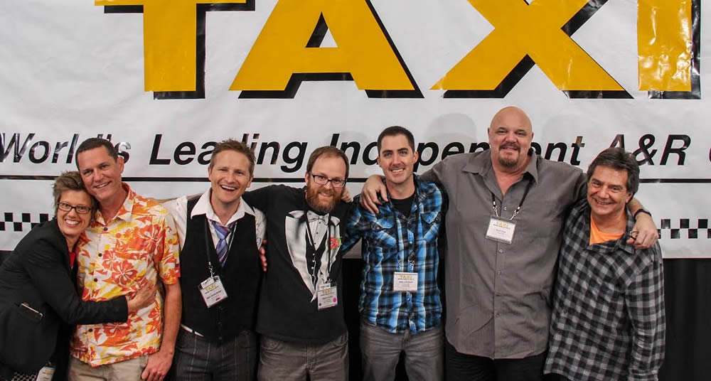 The Collaboration Nation panelists enjoy a little group bonding after their panel. It's pretty apparent how strong TAXI's community is in this photo. (Left to Right) C.K. Barlow, Russell Landwehr, Matt Vander Boegh, Steven Guiles, Seth Littlefield, Scott Free, and TAXI's Michael Laskow