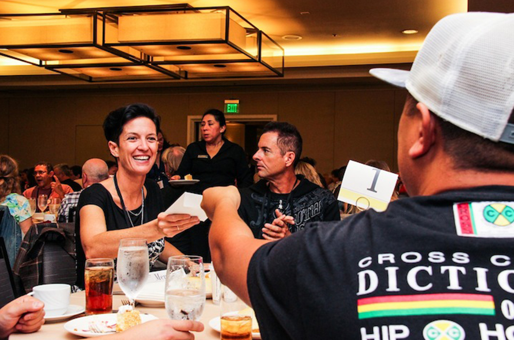 TAXI A&R person and Film/TV music expert Brooke Ferri takes some music from a member during the Mentor Lunch at our 20th Road Rally.