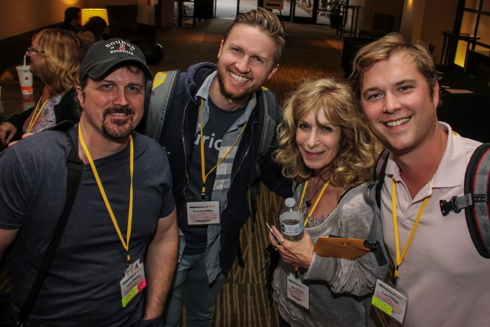 (left to right) TAXI members James Thacker, Brandon Mathias, Beth Wernick (CEO, Imaginary Friends), and Austin Fillingo look to be having a warm reunion at this year's convention.