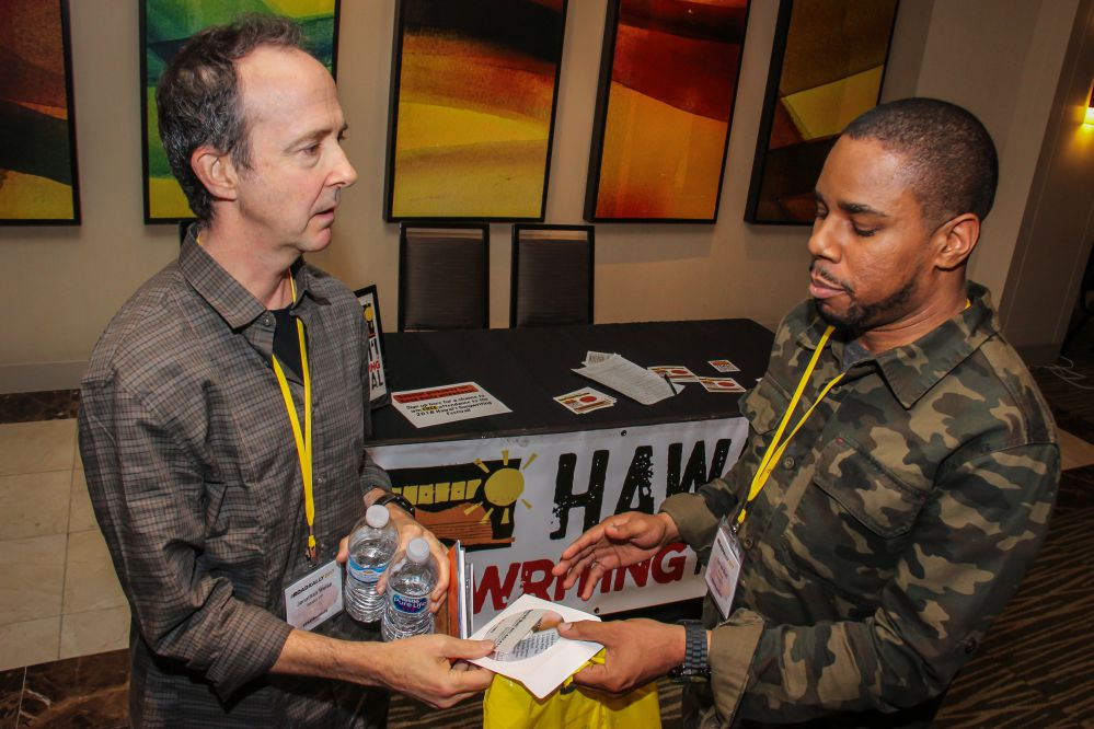 (left to right) Music Supervisor Jonathan Weiss takes a few minutes to hang out with and get some new music from TAXI Member Terrell Burt at the Road Rally.