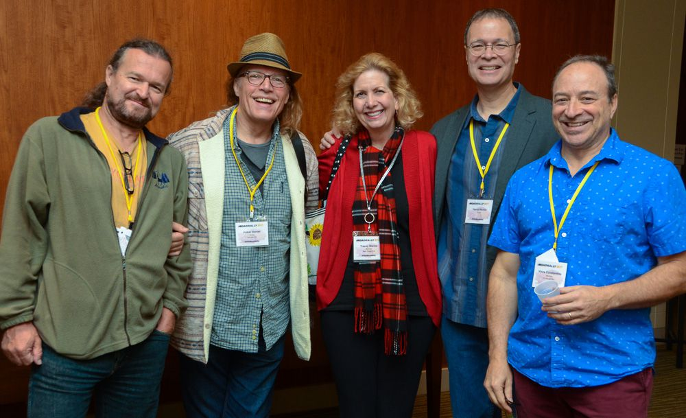 Successful composers and long-time friends Matt Hirt, Volker Barber, Tracey and Vance Marino, and Vince Constantino take a moment to grab a photo at TAXI's 2017 Road Rally.