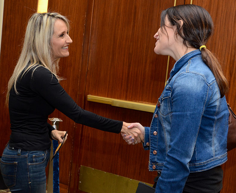 Hollywood film scoring composer Sharon Farber meets TAXI member Tamara Miller right after being interviewed on the Grand Ballroom stage during the Road Rally.