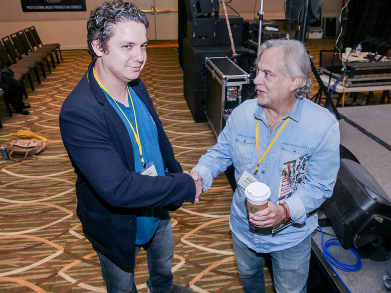 Music supervisor Mason Cooper meets a member after he finished his panel in the Grand Ballroom during TAXI's 22nd Road Rally convention.
