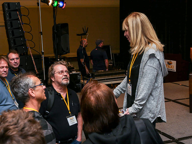 Music library owner Beth Wernick gets to know some TAXI members after her session wrapped up.