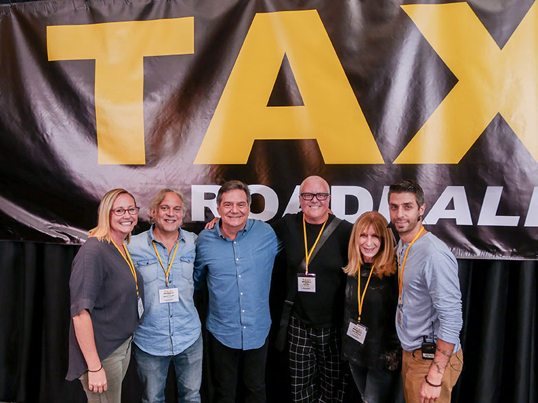 (Left to right) Music licensing executive Shannon Quisenberry, music supervisor Mason Cooper, TAXI's Michael Laskow, music library executives Bob Mair and Beth Wernick, and music supervisor Frank Palazzolo pose for a quick shot after their Film and TV Music Pitch Panel at TAXI's Road Rally.