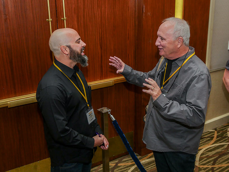 TAXI member Brian Curtin (right) enjoys a little one-on-one chat with reality TV video editor Timothy Hogarth.