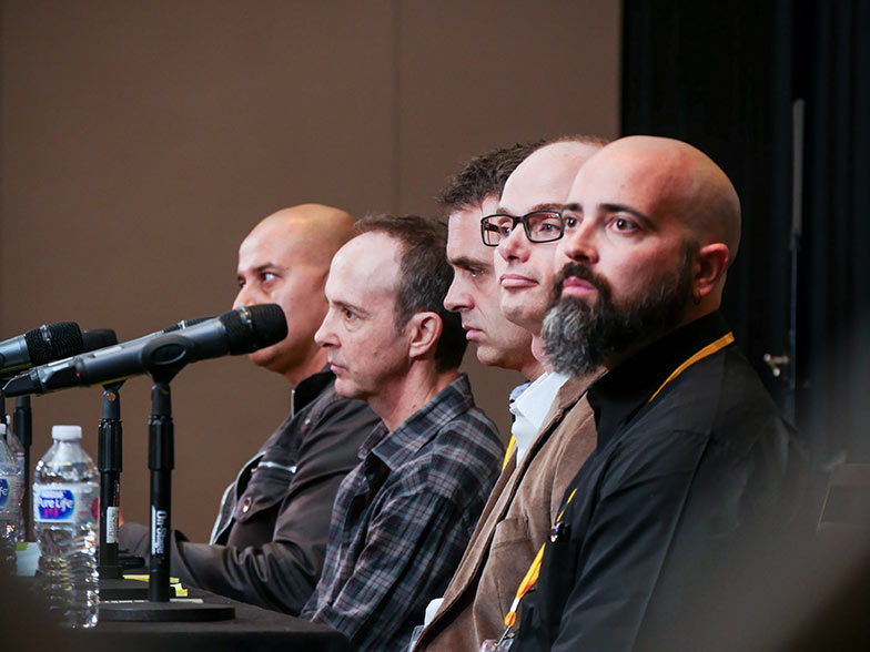 Joy Basu, Jonathan Weiss, Michael Kruk, Pedro Costa, and Timothy Hogarth are all paying close attention to an instrumental track played during the Instrumental Pitch panel at the Road Rally.