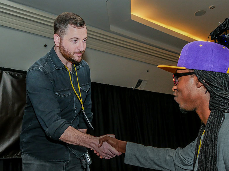 Music supervisor Naaman Snell looks like he's ready to ask a TAXI member where he got his awesome Laker hat.