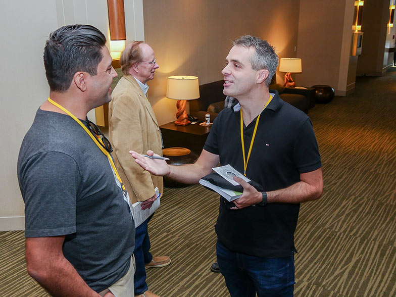 Music library CEO, Michael Kruk spends some time with a TAXI member after his panel at the Road Rally.