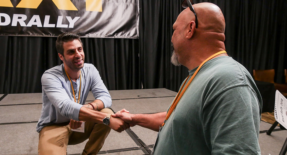 Music Supervisor Frank Palazzolo does a little post panel meet and greet with TAXI member Scott Free at TAXI's Road Rally, 2019.