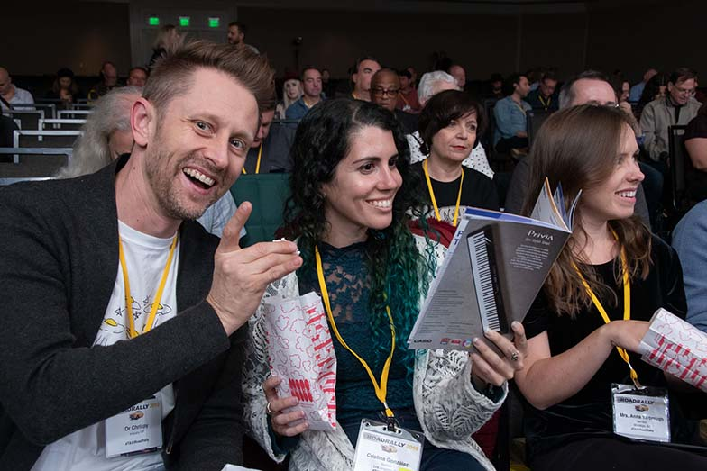 JTAXI Members Dr. Chrispy, Cristina González, and Anna Yarbrough enjoy the popcorn we gave the audience during one of the evening sessions in the Grand Ballroom.