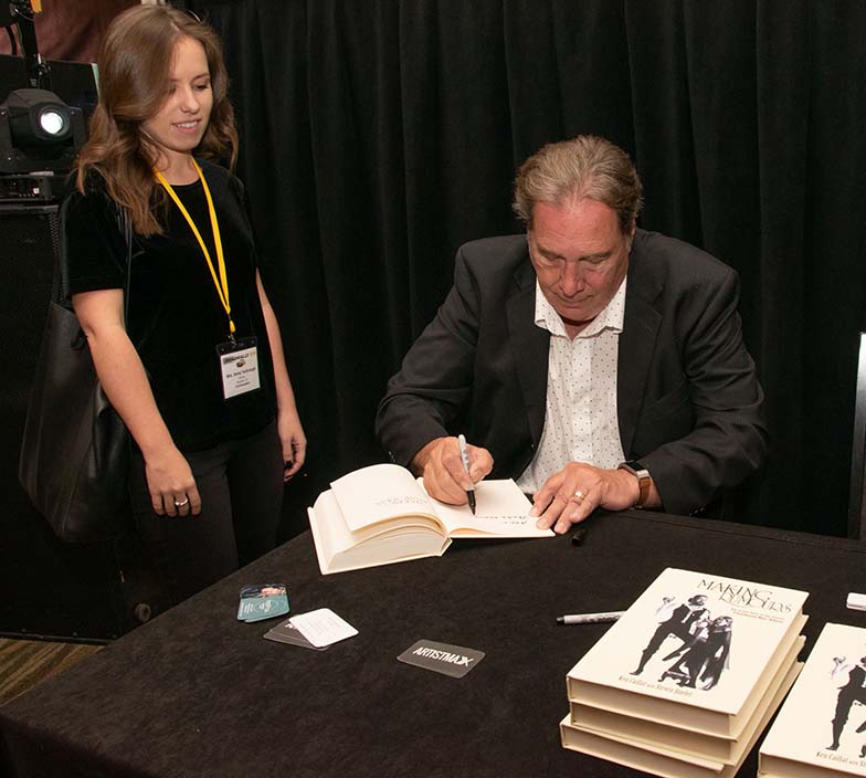 Ken Caillat signs a copy of his incredibly good book, Making Rumours for TAXI Member Anna Yarbrough.