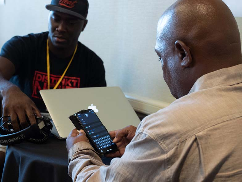 A&R person/producer Ty Knox gives some advice to a TAXI member during one of the One-to-One Mentor Sessions.