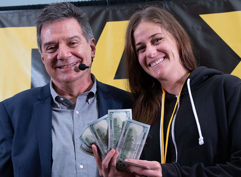 You'd think we would know the name of the person who won $500 in cash at the beginning of the Road Rally, but we can't see her badge. Believe it or not, we haven't yet memorized every member's name ;-) Congrats lady who is smiling!!
