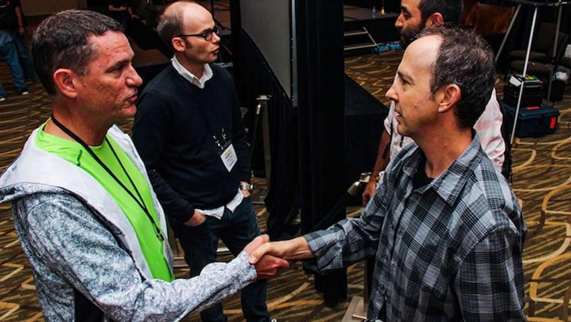 TAXI member Russell Landwehr (left) meets Music Supervisor Jonathan Weiss in the foreground during a recent TAXI Road Rally convention!